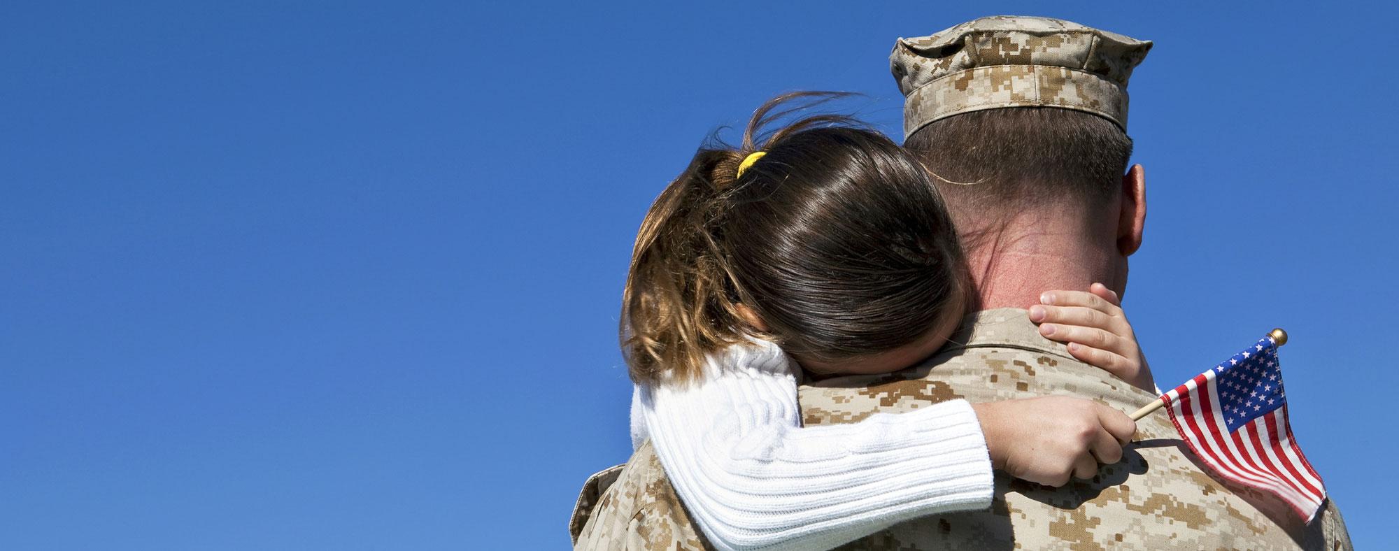 Veteran Holding Child